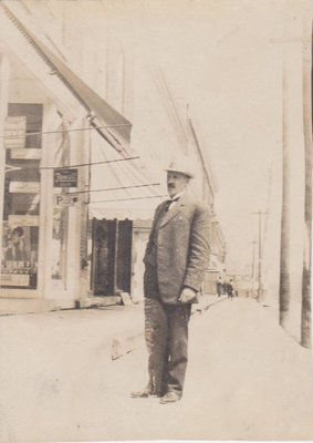 Photograph of Dr. W.A. Sargent on a King Street East wooden sidewalk, Colborne