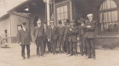 Photograph of a group of men on the platform at Grand Trunk Railway Station, Colborne