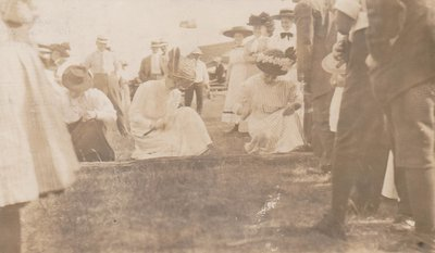 Postcard of ladies participating in a nail driving competition, Colborne Fair