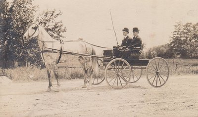 Postcard of two men driving a dapple-grey horse