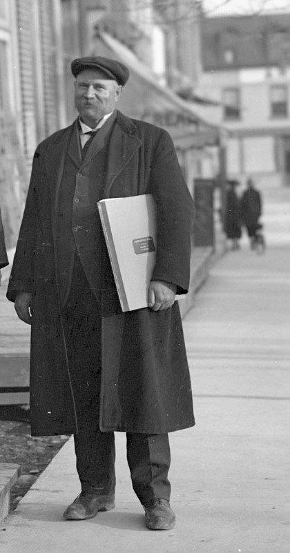 Exhibit, Chief Jamieson holding 1914 portfolio