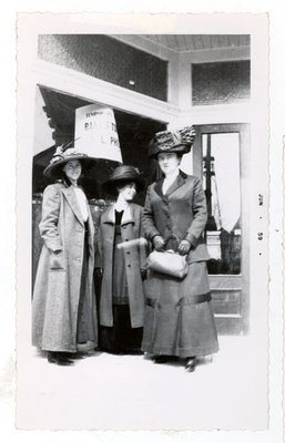 Photograph of three unidentified women standing in front of Colborne storefront, 1910s, Colborne Women's Institute Scrapbook