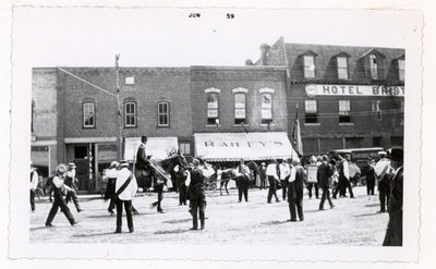 Photograph of a parade on King Street, Colborne Women's Institute Scrapbook