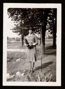 Photograph of an unidentified World War II nurse, Colborne Women's Institute Scrapbook