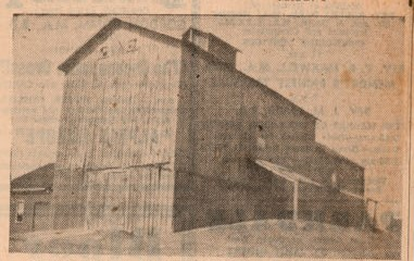 Newspaper photograph of grain elevator, Lakeport, Colborne Women's Institute Scrapbook