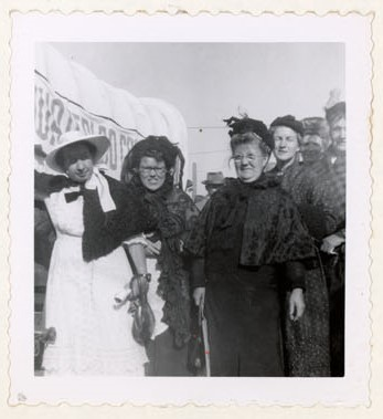 Photograph of Maude Kirk, Magaret Mackie, Maggie Mackie, Amy Gresham, Ellen MacGregor and Hattie McLaughlin, Women's Institute members at the 1953 Ploughing Match in Cobourg, Colborne Women's Institute Scrapbook