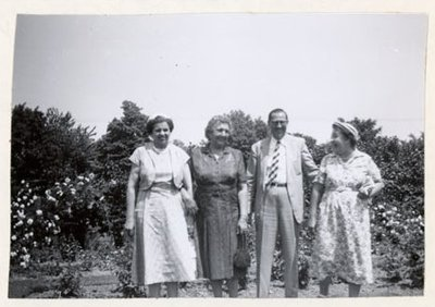 Photograph of Mrs. Myles, Mrs. McLaughlin, Dr. Robertson and Mrs. Maude Kirk, July 1955 trip to Ottawa, Colborne Women's Institute Scrapbook