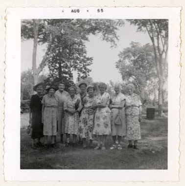 Photograph of Mrs. Watson, Miss F. Graham, Mrs. Ireland, Mrs. Thomas, Mrs. Grant, Mrs. Scott, Mrs. Parker, Mrs. Moore and Mrs. Armstrong, July 1955 picnic at Percy Boom, Colborne Women's Institute Scrapbook