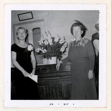 Photograph of Mrs. T.M. Gresham and Mrs. A.R. Mackie, 25th Anniversary, Colborne Women's Institute Scrapbook