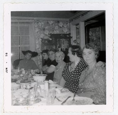 Photograph of Mrs. Scott, Miss Jean Ray, Mrs. Rush, Mrs. VanRoon and Mrs. Rae Mutton, 1958 Annual Meeting, Colborne Women's Institute Scrapbook