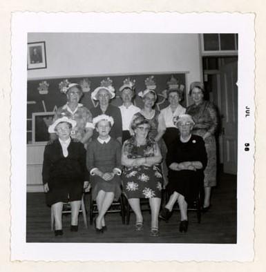 Photograph of Mrs. Grafton, Mrs. T.M. Gresham, Mrs. S.J. Cox, Miss E. Simmons, Mrs. E. McLaughlin, Mrs. J. G. Honey, Mrs. G. MacGregor, Mrs. E. Adams and Miss Milligan, Colborne Women's Institute Scrapbook