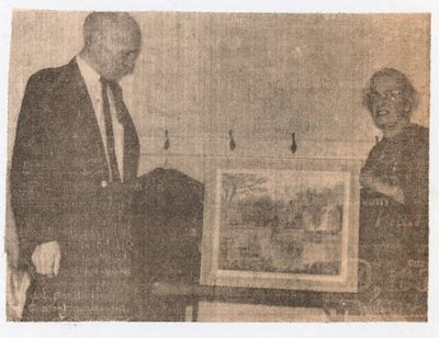 Newspaper photograph of Mrs. Earl Thompson and George Moore, Colborne Women's Institute Scrapbook
