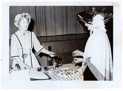 Photograph of Amy Gresham and Ellen MacGregor at Tweedsmuir tea fundraiser, Colborne Women's Institute Scrapbook