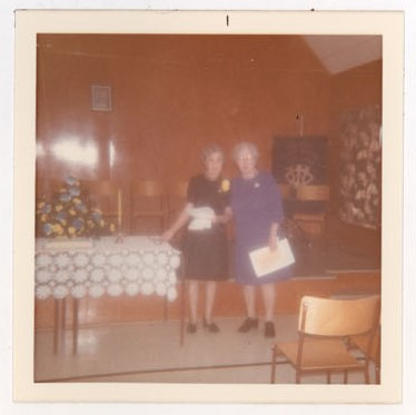 Photograph of Mrs. Ed Kernaghan and Mrs. Mac Rutherford, 40th W.I. Anniversary, Colborne Women's Institute Scrapbook