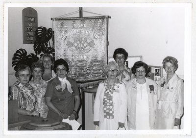 Photograph of Mrs. Gordon McGee, Mrs. Alex Rutherford, Miss Linda Caldwell, Mrs. Alec Glover, Mrs. Gordon McCulloch, Mrs. Dennis Moran, Mrs. C.H. Dallison and Mrs. Gordon Sherwin, 1978 Annual Meeting, Colborne W.I., Colborne Women's Institute Scrapbook