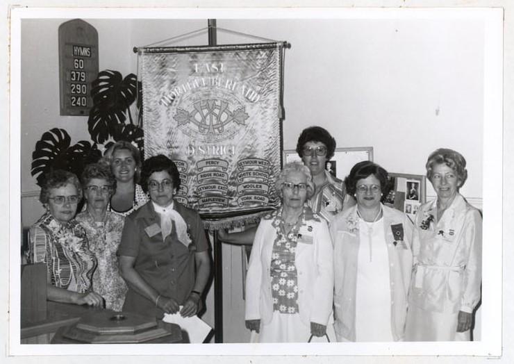 Photograph of Mrs. Gordon McGee, Mrs. Alex Rutherford, Miss Linda Caldwell, Mrs. Alec Glover, Mrs. Gordon McCulloch, Mrs. Dennis Moran, Mrs. C.H. Dallison and Mrs. Gordon Sherwin, 1978 Annual Meeting, Colborne W.I., Colborne Women's Institute Scrapbook