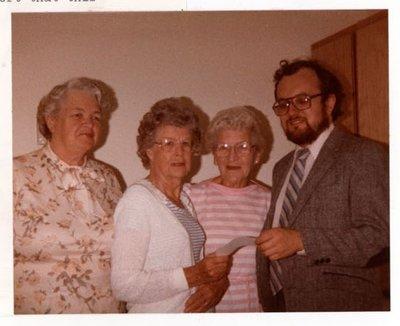 Photograph of Gladys Briggs, Elizabeth Rutherford, Amy Gresham and Dr. Trevor Hearnden, Colborne Women's Institute Scrapbook
