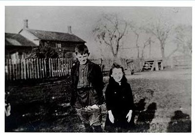 Photograph of Alex and Myrtle Lawson (Robson) in front of Samuel Marvin McComb house, and McComb family history, Castleton Women's Institute scrapbook