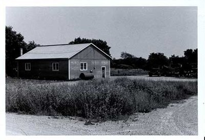 Photograph of John Day's garage, Castleton, Castleton Women's Institute scrapbook