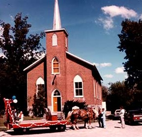 Photograph of Howard Somerville's horses in front of Castleton United Church, Cramahe Bicentennial