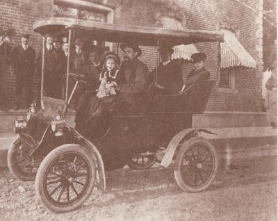 Photograph of the car used by the Coyle to transport passengers from the Grand Truck train station to the hotel.