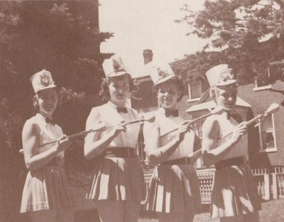 Photograph of Carol Conners, Marg McGuire, Betty Chatterson, and Lil Rutherford, Colborne High School majorettes, Cramahe Township
