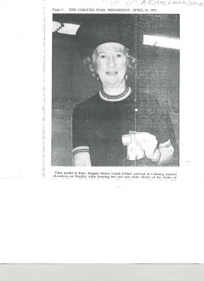 Photograph of Lenah Fisher holding her Medal of the Order of Canada.