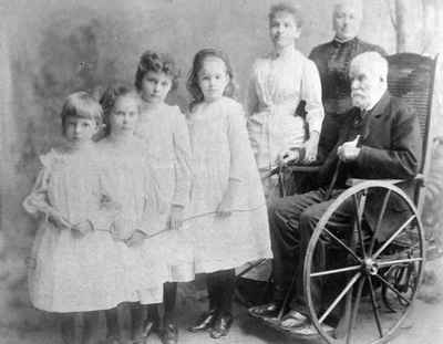Judge Boswell with four granddaughters, his second wife and a nurse