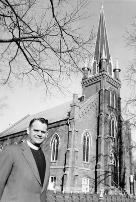 Rev G. Lockhart Royal stands in front of Norval Presbyterian Church.