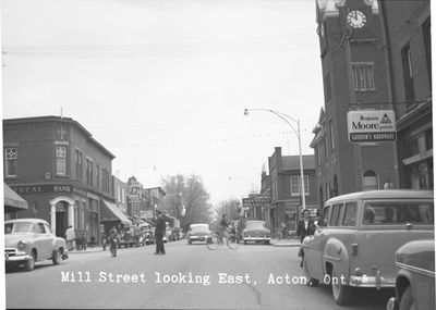 A Policeman Directs Traffic on Mill Street