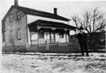 Man in front of Granny Hill's house c1910