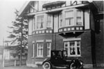 Gentleman starting motor car at Barraclough  House 1920
