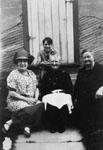Three ladies and a boy