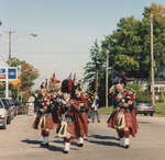 Scottish Pipers march and play in the Split Rail Parade