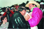 """Murray Betts """"kisses the pig"""""""