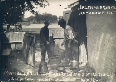 Nikolai Bokan and his son prepare buckets of water outside of their family home in anticipation of an arson attack.