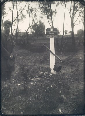 Nikolai Bokan stands beside the grave of his son Konstantin, who died of starvation.