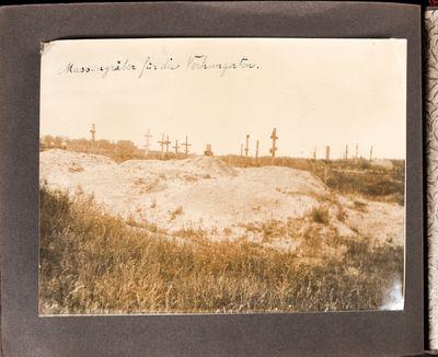 Freshly dug mass graves near an older existing cemetery near Kharkiv