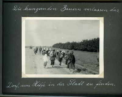 Several families from the countryside on their way to Kharkiv by foot
