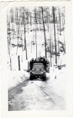 Logging Truck Going Uphill, Circa 1940