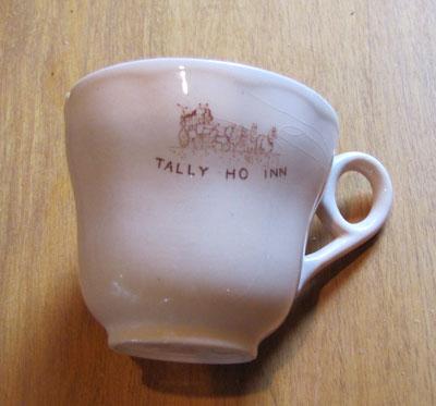 """Small China Tea Cup Peach Colored Qith """"Tally-Ho-inn"""" Logo, Circa 1940"""