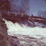 Bridge over Marsh's Falls on the Oxtongue River, Lake of Bays, Ontario. Spring 1951.