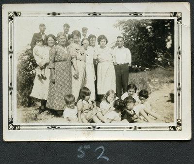 Ruby, Leonard, Leonard H., Grannie (holding June), A. Eliza, Edna, A.Ethel, Reuben, Francis Bea, Delbert, Loreen, Bernice, Molly, Seymour, Delores (at Mohawk Beach)