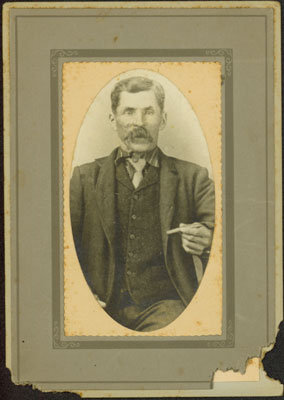 Portrait of a Man Holding a Cigar