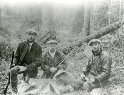 Jim Johannes and two fellow hunters pose with a slain deer, North Bay, Ontario