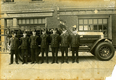 Kitchener Fire Department members in front of fire hall