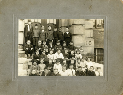 "Portrait of ""Jun R.2"" class on steps of Victoria School, Kitchener"