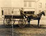Man in horse-drawn wagon on King Street, Waterloo, Ontario