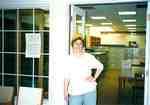 Susan Hoffman standing in the doorway of the Grace Schmidt Room of Local History