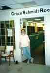 Susan Hoffman standing in doorway of Grace Schmidt Room of Local History